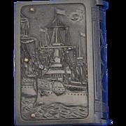 Battleship/Sailor motif match safe, book-shaped, vulcanite, c. 1900