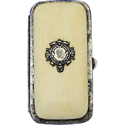 Purse-like match safe, celluloid, sterling and leather, c. 1890