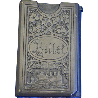 Railroad ticket holder match safe, book-shaped w/ floral design and train, vulcanite, c. 1895, French