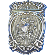 Unusual design, cartouche center surounded by flowers, match safe, sterling, c. 1900