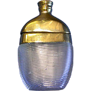 Figural glass flask match safe with brass trim, c. 1890