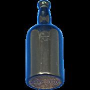 Figural whiskey bottle, c. 1910 bakelite