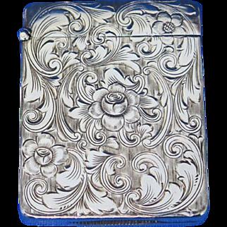 Floral motif match safe, rose design, sterling, c. 1900