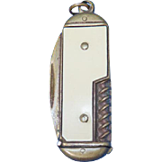 Figural penknife match safe, simulated knife blade and corkscrew, celluloid side panels, c. 1895