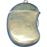 Figural kidney bean shaped match safe, brass, c. 1890