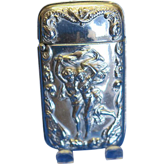 """Match safe with """"The Storm"""", copied from the painting by the French artist, Pierre Auguste Cot, nickel plated brass, c. 1890"""