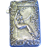 Nude couple on swing, match safe, silver plated, c. 1900