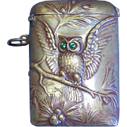 Owl on tree branch match safe, brass with green glass eyes, c. 1895
