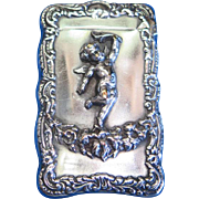 Cherub motif match safe, bold design, silver plated, c. 1900