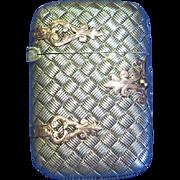 Figural trunk w/ basket weave design and gold straps, match safe, sterling, c. 1900