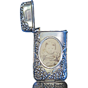 Hidden photo match safe with foliate edge design and original photo, sterling by Bassett Jewelry Co., c. 1900