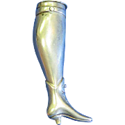 Figural lady's leg with high top shoe match safe, nickel plated brass, c. 1890