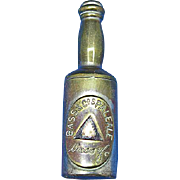 Figural Bass Pale Ale bottle match safe, brass, c. 1890