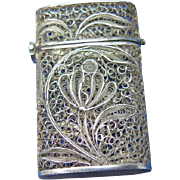 Filigree match safe with a delicate floral design, silver, c. 1895