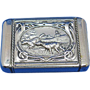 Hunting dogs on point and quail motifs match safe, insert type, by August Goertz, patented Jan 12, 1904