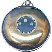 Pocket watch shaped match safe with dice game, brass, patent 21,091, Oct. 6, 1900