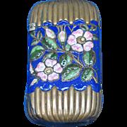 Enameled floral motif on brass match safe, c. 1895