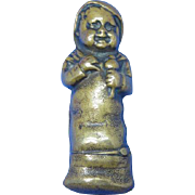 Figural baby holding a rattle rapped in bunting match safe, brass, c. 1890