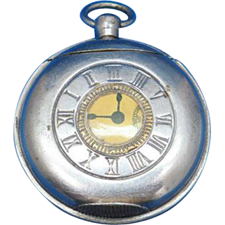Figural demi hunter pocket watch shaped match safe, enameled on nickel plated brass, c. 1900