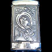Good luck symbols/buck in forest motif match safe with cigar cutter, by August Goertz, c. 1905