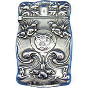 Trick opening match safe, floral and dog motif, sterling by F. S. Gilbert. c. 1900, bold features