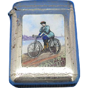 Lady riding bicycle, match safe, enamel on silver plate, c. 1895