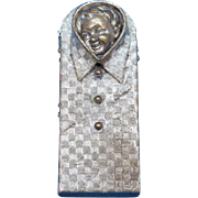 Figural baby's head in textured shirt match safe, c. 1895, brass
