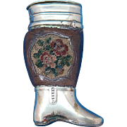 Figural leg with leather wrap and petit point decoration, plated brass, c. 1890