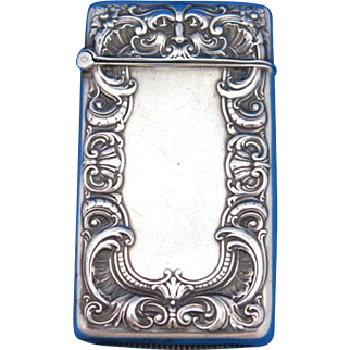 Foliate edge design & stylized face motif match safe, sterling by Gorham Mfg. Co., mfg. #B3801, c. 1910