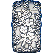 Flower motif and foliate edge design match safe, sterling, c. 1895