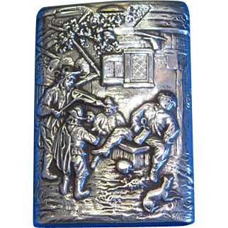 Fiddler playing to men, women and children, slide type match safe, 830 silver, by J.D. Schleissner Sohne, c. 1895