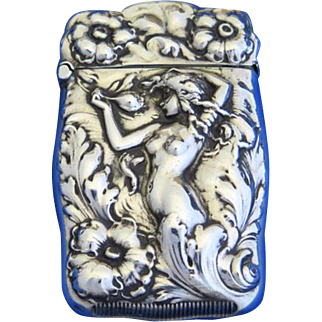 Nude woman and floral motif match safe, sterling, attributed to Webster Co., gold gilted interior. c. 1900