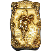Dancing nudes motif match safe, gold plated by Essex Silver Co., c. 1900