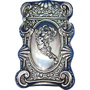 Stylized flying nude motif match safe, sterling, c. 1900, elaborate edge design. Possibly Daedalus or Lcarus of Greek legend