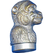 Figural monkey match safe, c. 1895, plated brass