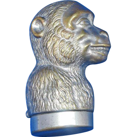 Figural monkey match safe, c. 1895, plated brass