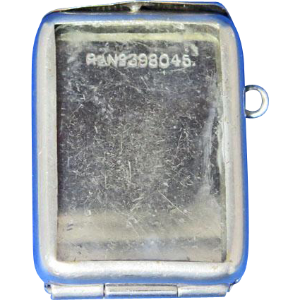 Photo match safe, protective glass, Rd.No.  398,045, 1902, nickel plated brass
