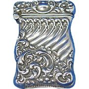 Floral and swirl motif match safe, sterling by Unger Bros, c. 1905