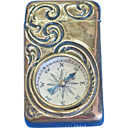 Brass match safe with swirl designs and working compass, c. 1890