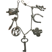 Sterling Charm Bracelet with Seven Charms, Turtle, Ape, Key, Horseshoe, Etc