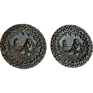 Matching Pair of Victorian Bronze Tone Metal Pictorial Buttons Draped Lady in Hammock