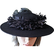 Spectacular 1960's Black Wide Brimmed Wool Hat with Silk Flowers & Back Ruffle Array