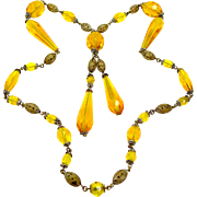 Czechoslovakia Golden Amber Glass and Brass Art Deco Necklace