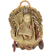 Vintage Wicker Doll Stroller with Metal Wheels & Bisque Baby Doll