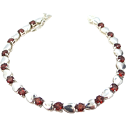 Pretty Sterling Silver and Garnets Tennis Bracelet