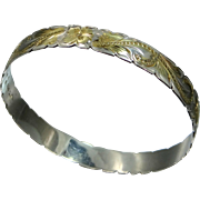 Beautiful Sterling Silver with a Gold Wash Floral Diamond Cut Bangle Bracelet