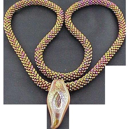Handmade Metallic Multi glass seed bead Necklace with Murano Glass Pendant.