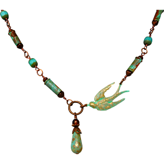 Asymmetrical Sparrow And Patina Bullet Shell Casings Necklace