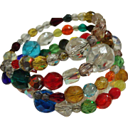 Vintage Coil of Many Colors Faceted Glass Bead Memory Wrap Bracelet