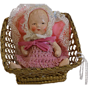 Antique German All Bisque Baby with Basket